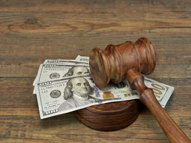 Gavel and money representing alimony laws in Colorado